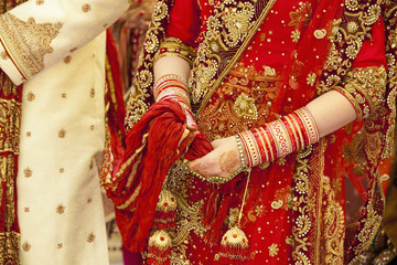 Ornate robes and jewelry worn by bride and groom on wedding day, Ludhiana, Punjab, India
