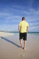 A Man Walks On The Wet Beach; Punta Cana, La Altagracia, Dominican Republic