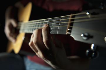 Playing A Guitar; Edmonton, Alberta, Canada