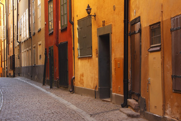 Street With Colourful Buildings In The Old Town; Stockholm, Sweden