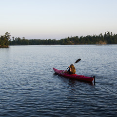 A Girl In A Kayak; Lake Of The Woods, Ontario, Canada