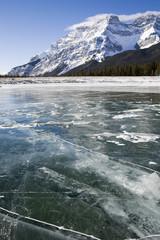 Frozen lake with snowcapped mountain, Banff, Alberta, Canada
