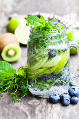 Detox  water. Homemade summer fruit drink with lime and kiwi and