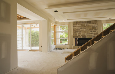 Unfinished Staircase And Living Room In An Upscale Residential Home; Quebec, Canada
