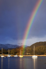 Rainbow Over A Harbour In Lake Windermere; Cumbria, England