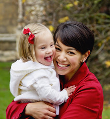 Portrait Of A Mother And Daughter Laughing; Cambridge, England