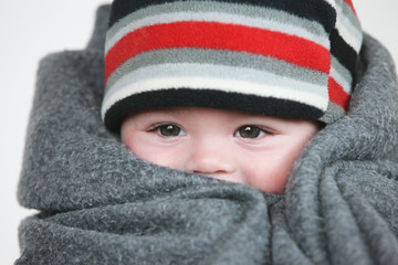 Baby Wrapped In A Grey Blanket With A Striped Hat; Troutdale, Oregon, United States of America