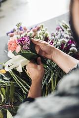 male florist working in flower shop