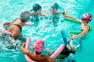 Kids having fun in swimming school