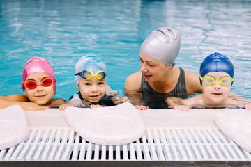 Cute kids having a swim lesson