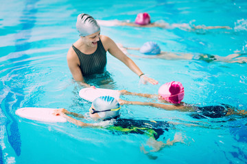 Kids having a race in swimming class