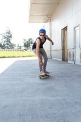 Young man and skateboard on the city street