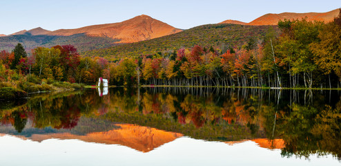 Reflection at sunset in Indian Head Lake in autumn, NH