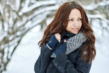 Beautiful pretty young woman in winter