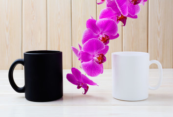 White and black mug mockup with pink orchid
