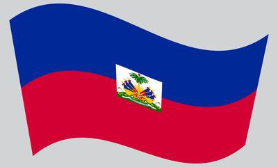 Flag of Haiti waving on gray background