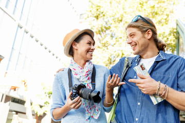 Smiling couple with the camera