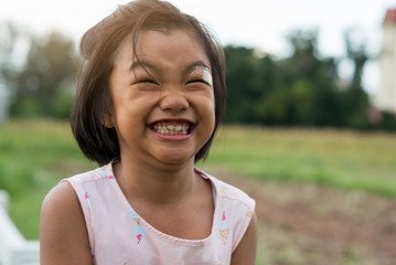 Cute little girl have broken teeth and smiling,asian child