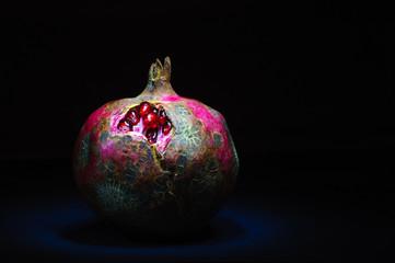 Pomegranate on a black background