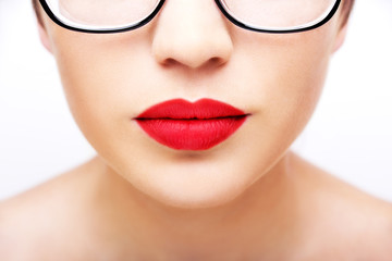 Plump sexy lips and perfect skin on a white background