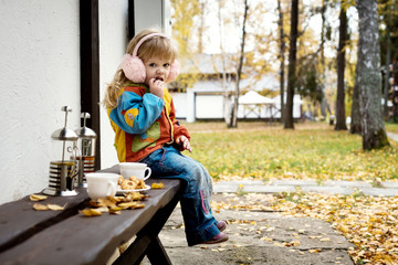 girl drinking tea outdoors in the fall