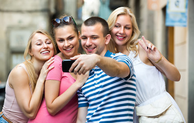 young people taking selfie outdoors .