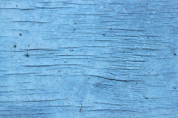 old wooden background with cracked blue paint