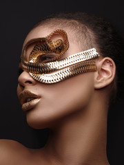 Fototapete - Luxury art studio portrait of an extraordinary beautiful nude african american model with perfect smooth glowing mulatto skin, make up, full golden lips, shaved haircut and gold jewelry, profile