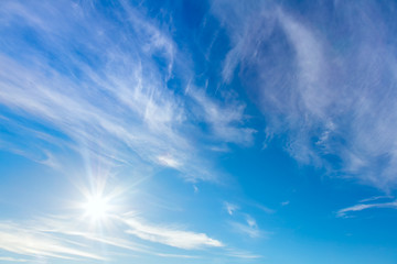 Happy Sunny background of blue sky with real sun