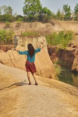 hippie girl dancing on cliff