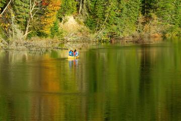 Canoe paddlers on Muskoka River in Ontario