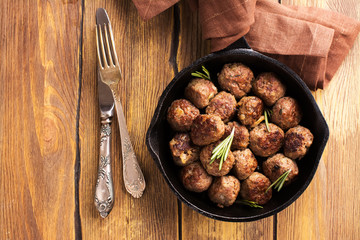 Roasted beef meatballs in an iron skillet