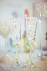 Wedding champagne flutes decorated with pearls and crystals