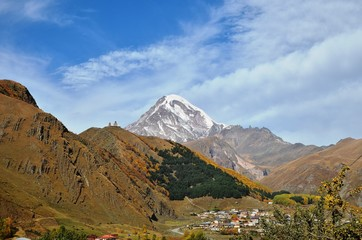 The icy Kazbek and Kazbegi village