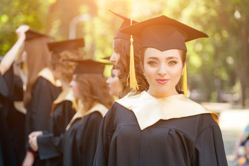 Graduate students wearing graduation hat and gown