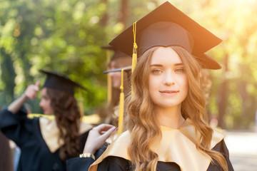 pretty female college graduate at graduation