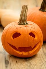 Smiling lantern pumpkin on a wooden background