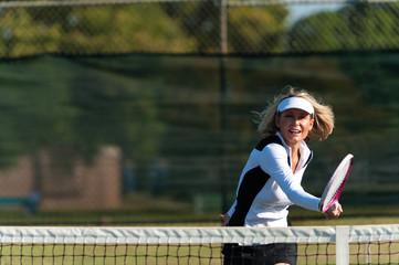 Blond Woman Playing Tennis