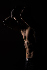 Strong Athletic Sexy Muscular Man on Black Background
