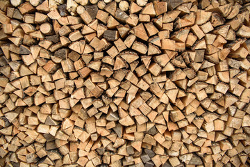 the wood stacked against the wall, rustic background