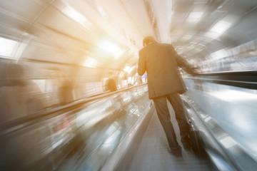 blurred passengers on a escalator