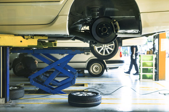 car wheel  suspension and brake system maintenance in auto serv