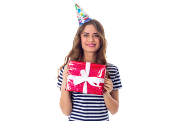 Woman in celebration cap holding a present