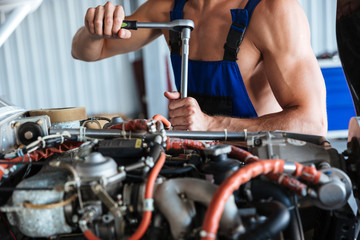 Repair man hands fixing engine on a plane