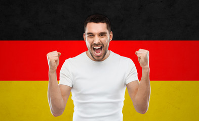 angry man showing fists over german flag