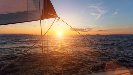 Wall Mural - Stunning sunset with sailing yachts in the Sea.