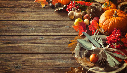 Autumn background from fallen leaves and fruits with vintage pla
