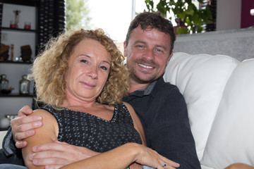 Middle aged handsome male and pretty female couple relaxing