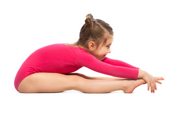 Little girl gymnast on a white background. Active lifestyle concept