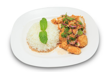 Thai cuisine mix spicy fried chicken with rice isolated on white background.